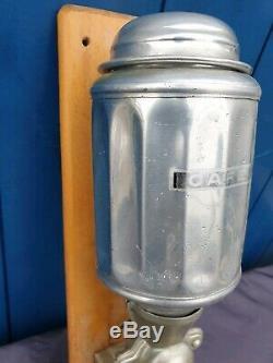 Antique Wall mounted coffee grinder art deco, cast aluminium. 1930s